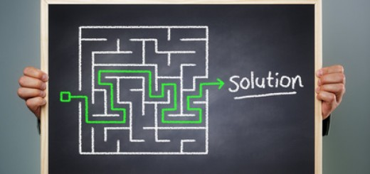 Business strategy businessman holding a blackboard planning and finding a solution through a chalk drawing of a maze